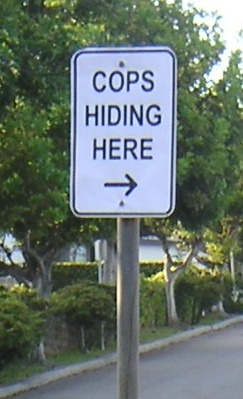 We will be telling scofflaws exactly where red light cameras are, so why not require cities to post this sign too?