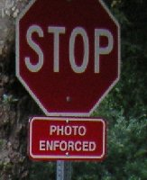 Stop sign with small 'Photo Enforced' warning sign, Franklin Canyon